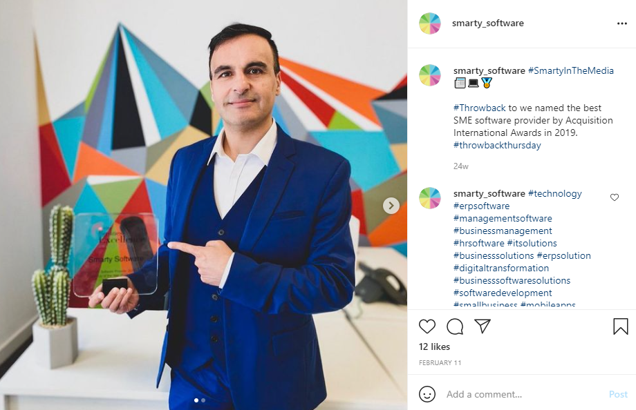 Screenshot of Smarty Software's Instagram showing Doctor Farhad Reyazat in a blue suit. He is stood in front of a wall with colourful geometric designs. He is holding an award for the Best Startup and Best Product of 2019. There is a small cactus on the desk behind him. Building an online presence.